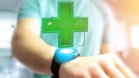 Homem de negócios que guarda uma cruz da farmácia da iluminação e um estetoscópio Fotografia de Stock Royalty Free
