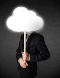 Homem de negócios que guarda uma nuvem Imagens de Stock Royalty Free