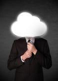 Homem de negócios que guarda uma nuvem Fotos de Stock Royalty Free