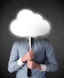 Homem de negócios que guarda uma nuvem Imagens de Stock
