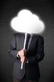 Homem de negócios que guarda uma nuvem Fotos de Stock