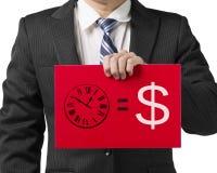 Homem de negócios que guardara uma placa vermelha com tiragem Tempo é dinheiro do conceito Fotos de Stock Royalty Free