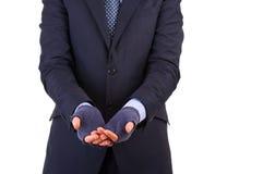 Homem de negócios que implora pelo dinheiro. fotografia de stock