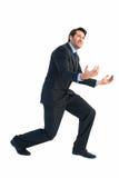 Homem de negócios que leva algo pesado com suas mãos imagem de stock royalty free