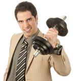 Homem de negócios que levanta um peso Imagem de Stock Royalty Free