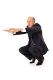 Homem de negócios que limbering acima Imagens de Stock Royalty Free