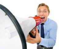 Homem de negócios que mantém o megafone isolado no fundo branco imagem de stock