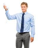 Homem de negócios que mantém o telefone análogo isolado no fundo branco foto de stock