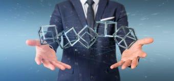 Homem de negócios que mantém um cubo do blockchain da rendição 3d isolado na Foto de Stock Royalty Free