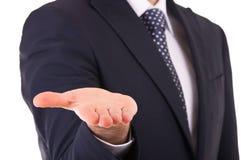 Homem de negócios que mostra a mão vazia. fotografia de stock