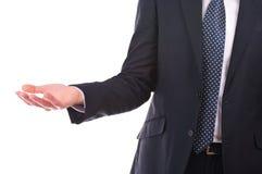 Homem de negócios que mostra a mão vazia. foto de stock