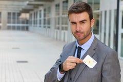 Homem de negócios que mostra o ás de corações Foto de Stock Royalty Free