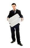 Homem de negócios que mostra o recipiente do metal Imagens de Stock