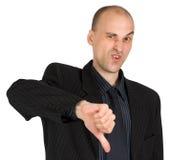 Homem de negócios que mostra os polegares para baixo Imagens de Stock Royalty Free