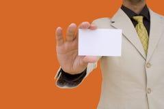 Homem de negócios que mostra seu cartão imagem de stock royalty free
