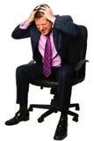 Homem de negócios que olha forçado imagens de stock
