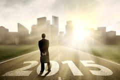 Homem de negócios que olha 2015 futuro Foto de Stock