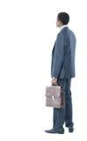 Homem de negócios que olha no fundo Fotos de Stock