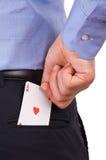 Homem de negócios que põe o cartão do ás no bolso traseiro. Foto de Stock Royalty Free