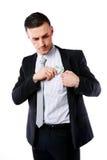 Homem de negócios que põe o dinheiro no bolso foto de stock royalty free