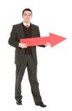 Homem de negócios que prende a seta vermelha imagem de stock