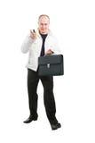 Homem de negócios que prende seus móbil e caso nas mãos Imagem de Stock Royalty Free