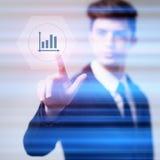 Homem de negócios que pressiona telas virtuais do botão Foto de Stock Royalty Free