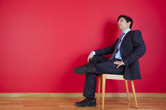 Homem de negócios que relaxa fotografia de stock royalty free