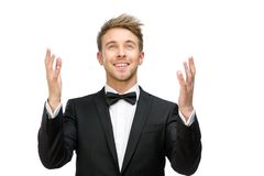 Homem de negócios que reza com mãos acima foto de stock