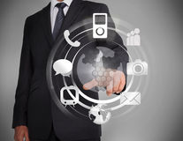 Homem de negócios que seleciona um holograma Imagens de Stock Royalty Free