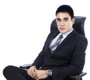 Homem de negócios que senta-se na cadeira fotos de stock
