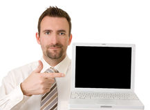 Homem de negócios que sustenta o portátil com trajeto de grampeamento Fotografia de Stock