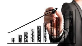 Homem de negócios que tira um gráfico de barra de ascensão Fotos de Stock Royalty Free