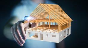 Homem de negócios que toca em 3D que rende a casa inacabado do plano com o seu Fotografia de Stock Royalty Free