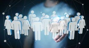Homem de negócios que toca em 3D que rende o grupo de pessoas com seu finge Foto de Stock Royalty Free