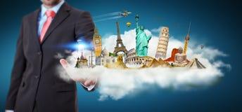 Homem de negócios que toca em uma nuvem completamente de monumentos famosos com seu f Fotografia de Stock Royalty Free