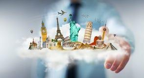 Homem de negócios que toca em uma nuvem completamente de monumentos famosos com seu f Foto de Stock