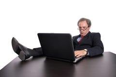 Homem de negócios que trabalha com portátil fotografia de stock royalty free