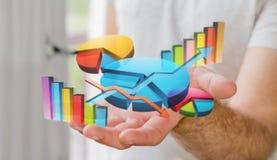 Homem de negócios que usa as cartas 3D e barras digitais Fotos de Stock Royalty Free