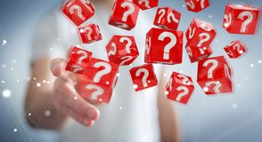 Homem de negócios que usa cubos com o 3D que rende pontos de interrogação Fotos de Stock