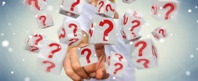 Homem de negócios que usa cubos com o 3D que rende pontos de interrogação Imagem de Stock Royalty Free