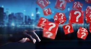 Homem de negócios que usa cubos com o 3D que rende pontos de interrogação Imagens de Stock