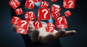 Homem de negócios que usa cubos com o 3D que rende pontos de interrogação Imagem de Stock