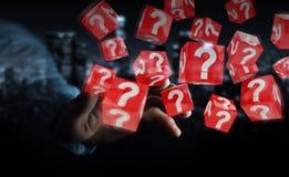 Homem de negócios que usa cubos com o 3D que rende pontos de interrogação Fotografia de Stock Royalty Free