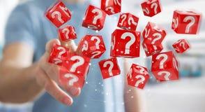 Homem de negócios que usa cubos com o 3D que rende pontos de interrogação Fotografia de Stock