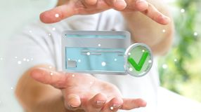Homem de negócios que usa o cartão de crédito para pagar a rendição 3D em linha Imagem de Stock Royalty Free
