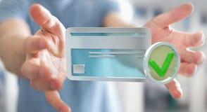 Homem de negócios que usa o cartão de crédito para pagar a rendição 3D em linha Imagens de Stock