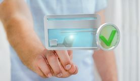 Homem de negócios que usa o cartão de crédito para pagar a rendição 3D em linha Fotografia de Stock Royalty Free