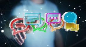 Homem de negócios que usa o ico colorido digital da conversação da rendição 3D Foto de Stock Royalty Free