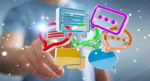 Homem de negócios que usa o ico colorido digital da conversação da rendição 3D Fotos de Stock Royalty Free